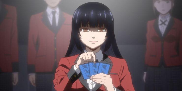 Kakegurui-Yumeko-Smiling-While-Playing-Cards